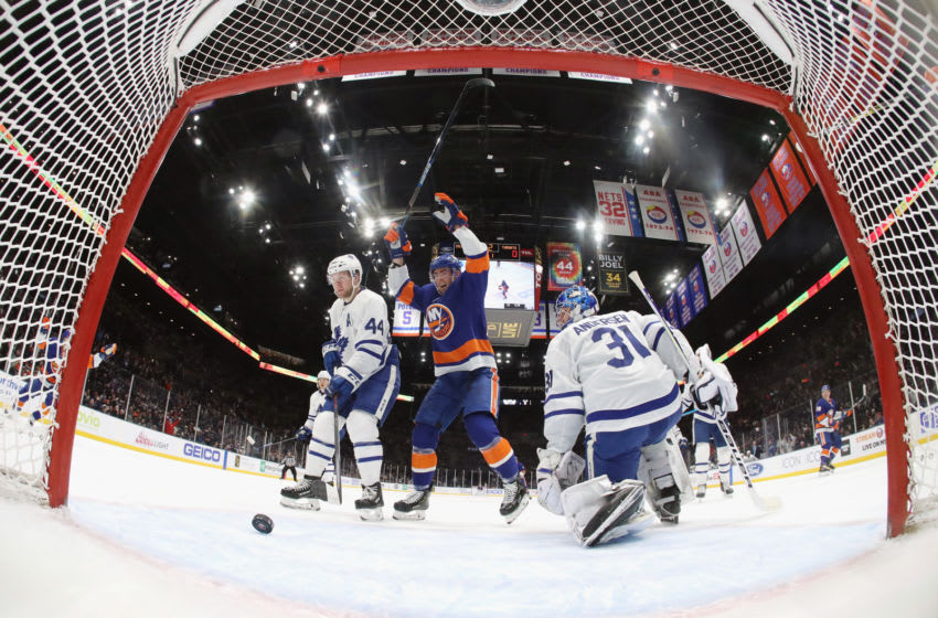 UNIONDALE, NEW YORK - NOVEMBER 13: Mathew Barzal #13 and Brock Nelson #29 of the New York Islanders celebrate a power-play goal by Anthony Beauvillier #18 against Frederik Andersen #31 of the Toronto Maple Leafs at NYCB Live's Nassau Coliseum on November 13, 2019 in Uniondale, New York. (Photo by Bruce Bennett/Getty Images)