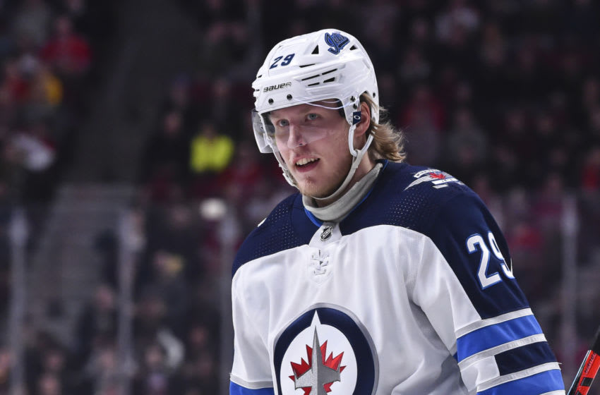 MONTREAL, QC - JANUARY 06: Patrik Laine #29 of the Winnipeg Jets looks on against the Montreal Canadiens during the first period at the Bell Centre on January 6, 2020 in Montreal, Canada. The Winnipeg Jets defeated the Montreal Canadiens 3-2. (Photo by Minas Panagiotakis/Getty Images)