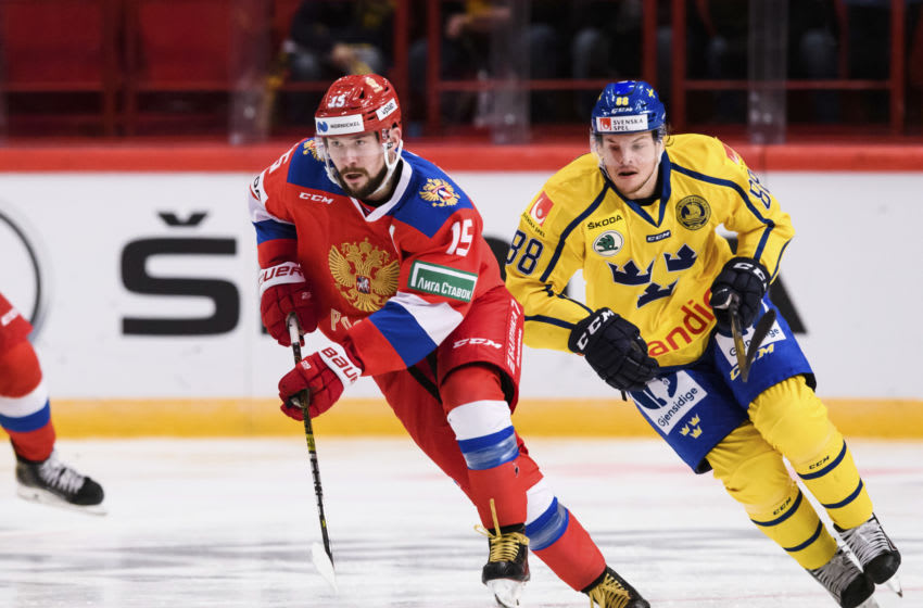 Russia's Anatoly Golyshev vies for the puck with Sweden's Malte Stromwall during the Beijer Hockey Games match between Sweden and Russia at the Ericson Globe Arena in Stockholm, Sweden, on February 08, 2020. (Photo by Erik SIMANDER / TT NEWS AGENCY / AFP) / Sweden OUT (Photo by ERIK SIMANDER/TT NEWS AGENCY/AFP via Getty Images)