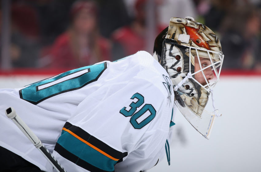 GLENDALE, ARIZONA - JANUARY 14: Goaltender Aaron Dell #30 of the San Jose Sharks looks down ice during the first period of the NHL game against the Arizona Coyotes at Gila River Arena on January 14, 2020 in Glendale, Arizona. (Photo by Christian Petersen/Getty Images)