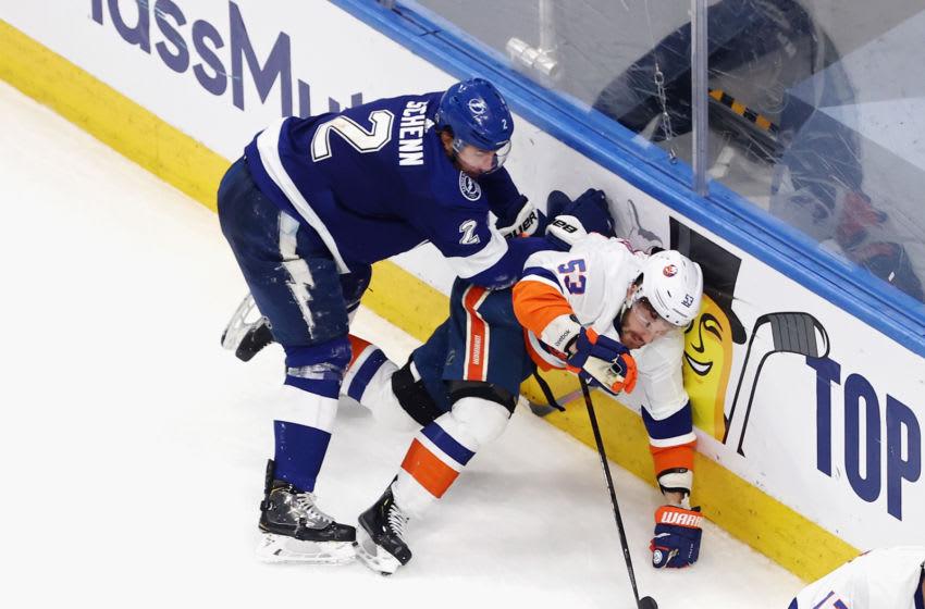 Luke Schenn #2 of the Tampa Bay Lightning checks Casey Cizikas #53 of the New York Islanders (Photo by Bruce Bennett/Getty Images)
