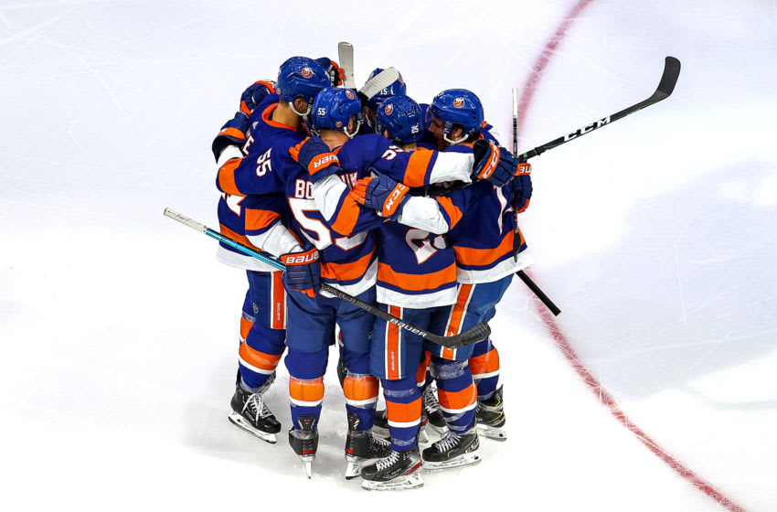 EDMONTON, ALBERTA - SEPTEMBER 17: Devon Toews #25 of the New York Islanders is congratulated by his teammates after scoring a goal against the Tampa Bay Lightning during the first period in Game Six of the Eastern Conference Final during the 2020 NHL Stanley Cup Playoffs at Rogers Place on September 17, 2020 in Edmonton, Alberta, Canada. (Photo by Bruce Bennett/Getty Images)