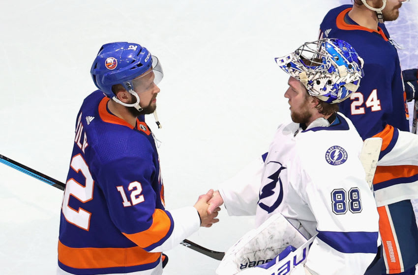 EDMONTON, ALBERTA - SEPTEMBER 17: Josh Bailey #12 of the New York Islanders and Andrei Vasilevskiy #88 of the Tampa Bay Lightning shake hands following the Lightning's series win over the Islanders in Game Six of the Eastern Conference Final during the 2020 NHL Stanley Cup Playoffs at Rogers Place on September 17, 2020 in Edmonton, Alberta, Canada. (Photo by Bruce Bennett/Getty Images)