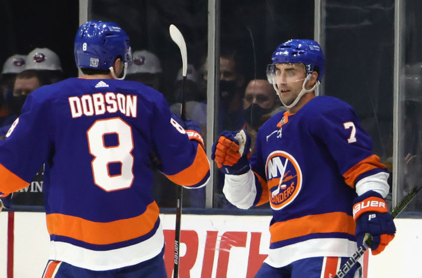 UNIONDALE, NEW YORK - FEBRUARY 06: Jordan Eberle #7 of the New York Islanders (R) celebrates his goal at 10:22 of the first period against Tristan Jarry #35 of the Pittsburgh Penguins as he is joined by Noah Dobson #8 (L) at the Nassau Coliseum on February 06, 2021 in Uniondale, New York. (Photo by Bruce Bennett/Getty Images)