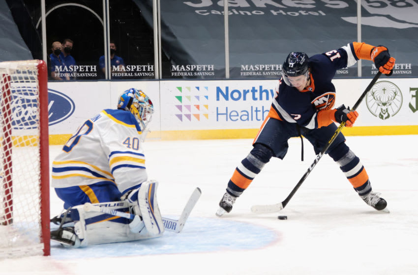UNIONDALE, NEW YORK - MARCH 06: Mathew Barzal #13 of the New York Islanders scores at 3:51 of the second period against Carter Hutton #40 of the Buffalo Sabres at the Nassau Coliseum on March 06, 2021 in Uniondale, New York. (Photo by Bruce Bennett/Getty Images)