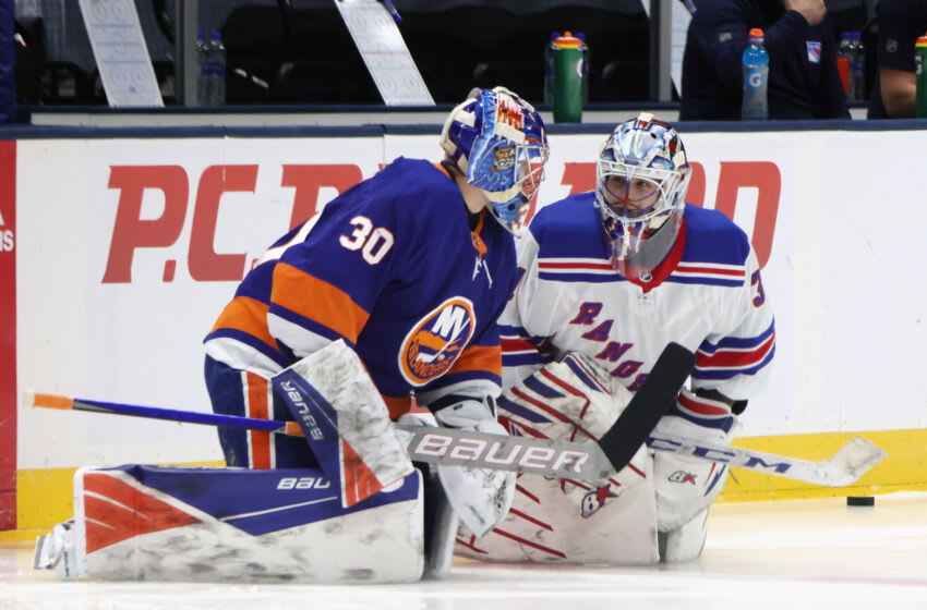 UNIONDALE, NEW YORK - APRIL 09: Fellow Russian goaltenders Ilya Sorokin #30 of the New York Islanders and Igor Shesterkin #31 of the New York Rangers chat during warm-ups prior to their game at Nassau Coliseum on April 09, 2021 in Uniondale, New York. (Photo by Bruce Bennett/Getty Images)