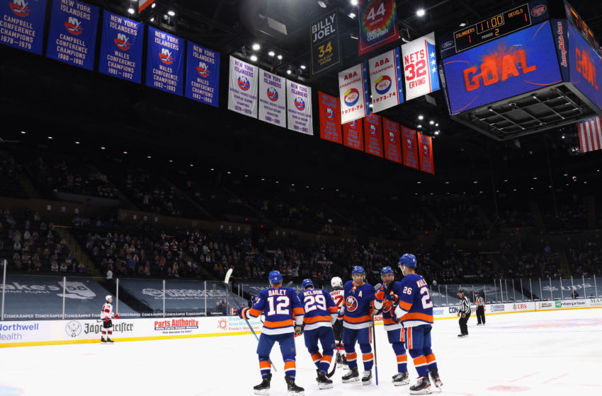 UNIONDALE, NEW YORK - MAY 08: The New York Islanders celebrate a second period goal by Oliver Wahlstrom #26 (R) against the New Jersey Devils at the Nassau Coliseum on May 08, 2021 in Uniondale, New York. (Photo by Bruce Bennett/Getty Images)