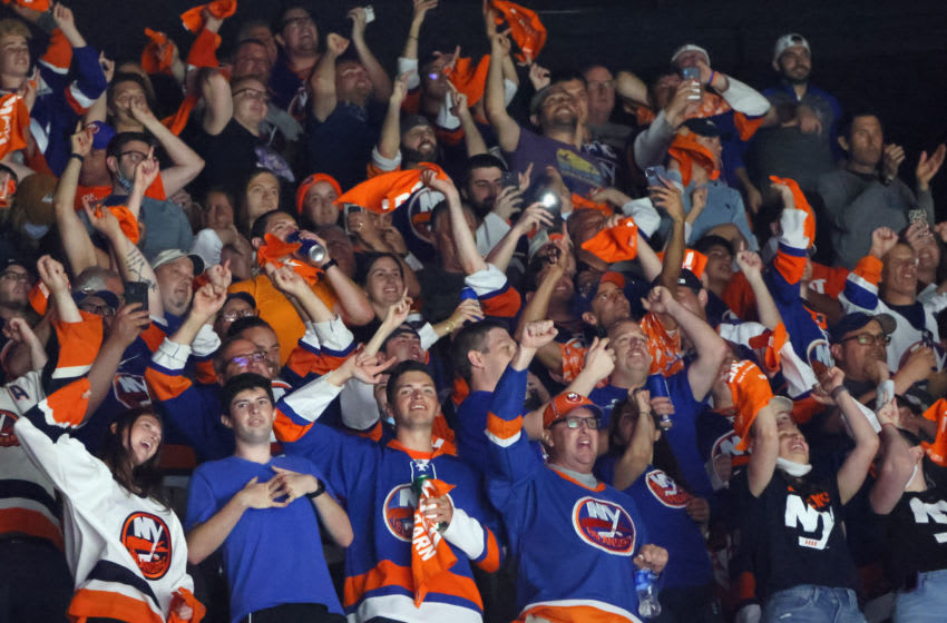 UNIONDALE, NEW YORK - JUNE 09: New York Islanders fans celebrate during the second period against the Boston Bruins in Game Six of the Second Round of the 2021 NHL Stanley Cup Playoffs at the Nassau Coliseum on June 09, 2021 in Uniondale, New York. (Photo by Bruce Bennett/Getty Images)