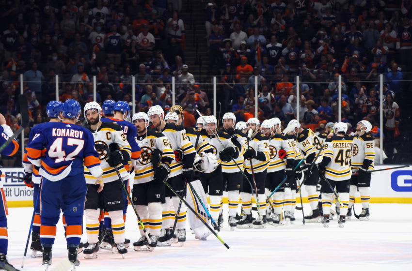 UNIONDALE, NEW YORK - JUNE 09: The Boston Bruins and the New York Islanders shake hands following the Islanders 6-2 victory in Game Six of the Second Round of the 2021 NHL Stanley Cup Playoffs at the Nassau Coliseum on June 09, 2021 in Uniondale, New York. (Photo by Bruce Bennett/Getty Images)