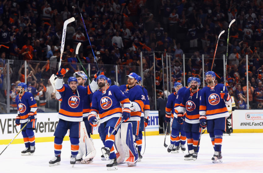 UNIONDALE, NEW YORK - JUNE 09: The New York Islanders celebrate their 6-2 victory over the Boston Bruins in Game Six of the Second Round of the 2021 NHL Stanley Cup Playoffs at the Nassau Coliseum on June 09, 2021 in Uniondale, New York. (Photo by Bruce Bennett/Getty Images)