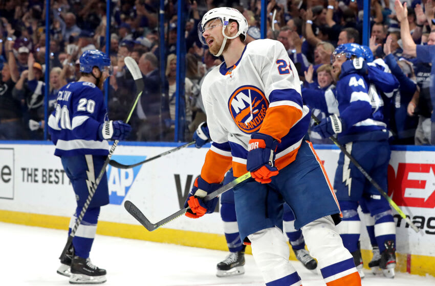 TAMPA, FLORIDA - JUNE 21: Scott Mayfield #24 of the New York Islanders reacts to a goal by Yanni Gourde #37 of the Tampa Bay Lightning during the first period in Game Five of the Stanley Cup Semifinals during the 2021 Stanley Cup Playoffs at Amalie Arena on June 21, 2021 in Tampa, Florida. (Photo by Mike Carlson/Getty Images)