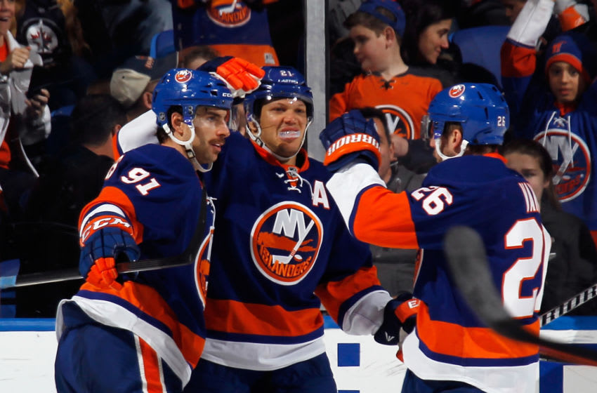 John Tavares #91, Kyle Okposo #21 and Thomas Vanek #26 of the New York Islanders (Photo by Bruce Bennett/Getty Images)