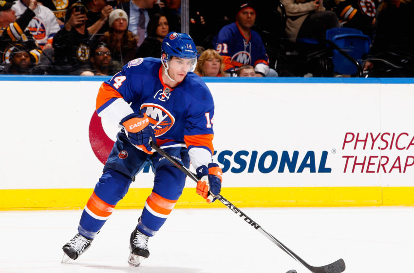 UNIONDALE, NY - JANUARY 29: Thomas Hickey #14 of the New York Islanders in action against the Boston Bruins during their game at the Nassau Veterans Memorial Coliseum on January 29, 2015 in Uniondale, New York. (Photo by Al Bello/Getty Images)