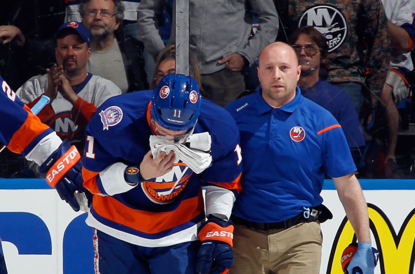 UNIONDALE, NY - APRIL 21: Lubomir Visnovsky #11 of the New York Islanders leaves the game after a hit by Tom Wilson #43 of the Washington Capitals during the second period in Game Four of the Eastern Conference Quarterfinals during the 2015 NHL Stanley Cup Playoffs at Nassau Veterans Memorial Coliseum on April 21, 2015 in Uniondale, New York. (Photo by Bruce Bennett/Getty Images)