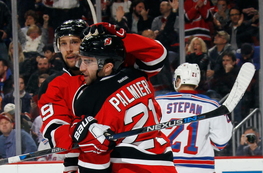 NEWARK, NJ - FEBRUARY 23: Travis Zajac #19 and Kyle Palmieri #21 of the New Jersey Devils celebrate Palmieri's powerplay goal at 10:28 of the second period against the New York Rangers at the Prudential Center on February 23, 2016 in Newark, New Jersey. (Photo by Bruce Bennett/Getty Images)