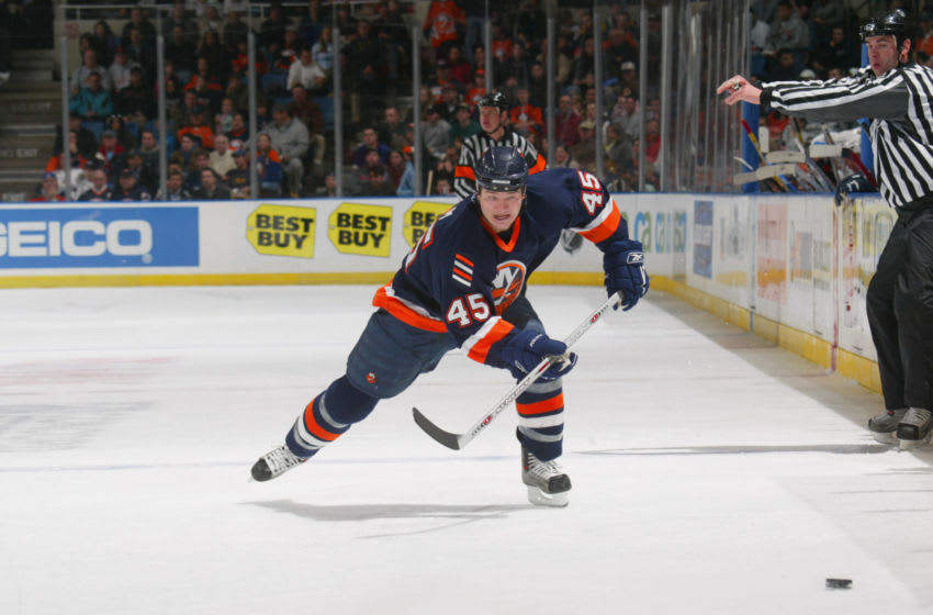 UNIONDALE, NY - NOVEMBER 25: Right wing Arron Asham #45 of the New York Islanders chases the puck during the game against the Ottawa Senators at the Nassau Coliseum on November 25, 2005 in Uniondale, New York. The Senators won 6-2. (Photo by Bruce Bennett/Getty Images)