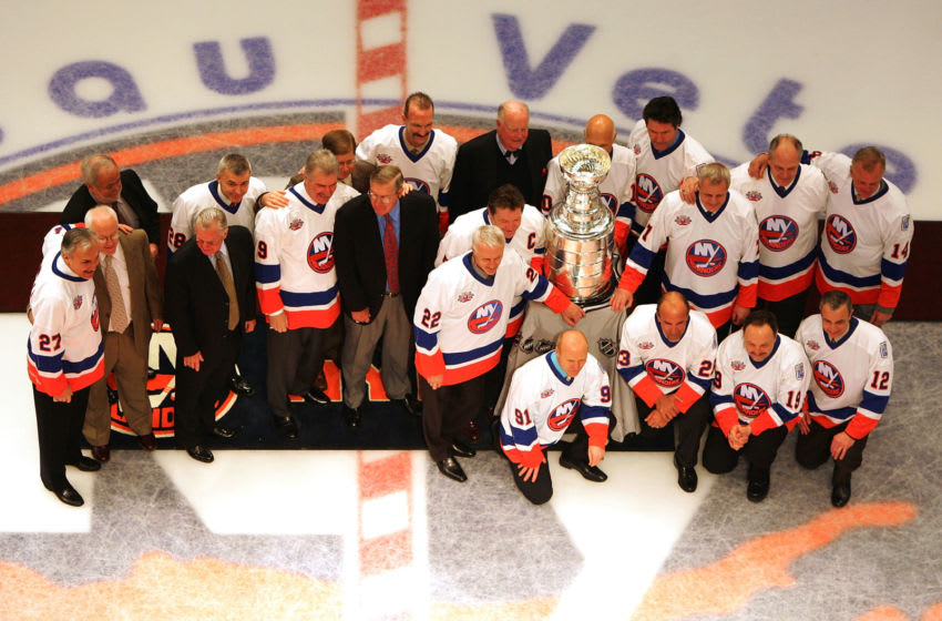 UNIONDALE, NY - MARCH 02: Former New York Islanders pose with the Stanley Cup before the game against the Florida Panthers at the Nassau Coliseum March 2, 2008 in Uniondale, New York. The Islanders are celebrating the 17 men that were part of all four Stanley Cup winning teams from 1980-1983. (Photo by Jim McIsaac/Getty Images)