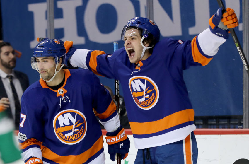 NEW YORK, NEW YORK - DECEMBER 16: Jordan Eberle #7 of the New York Islanders is congratulated by teammae Mathew Barzal #13 after Eberle scored the game winning goal in overtime against the Los Angeles Kings on December 16, 2017 at Barclays Center in the Brooklyn borough of New York City.The New York Islanders defeated the Los Angeles Kings 4-3 in overtime. (Photo by Elsa/Getty Images)