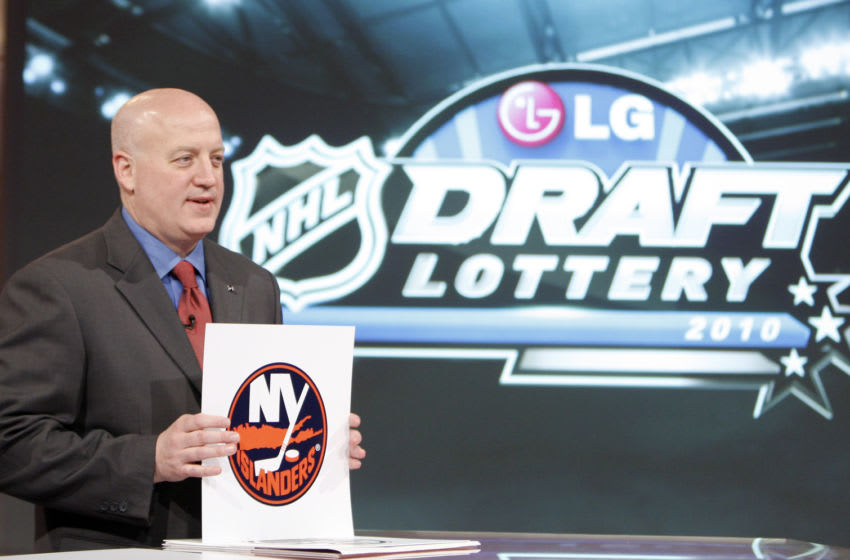 Deputy Commissioner of the NHL Bill Daly announces the fifth pick to go to the New York Islanders (Photo by Abelimages / Getty Images for NHL)