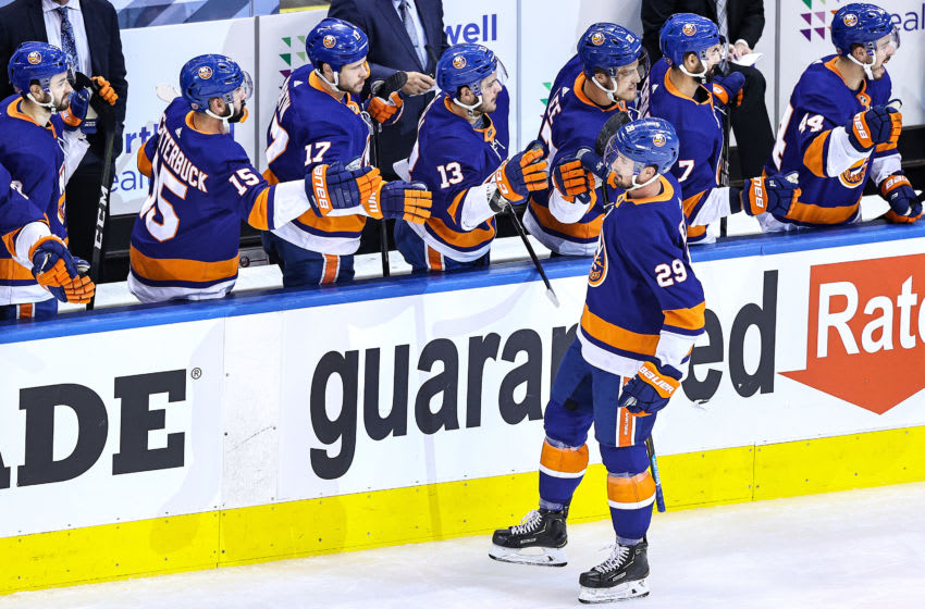 TORONTO, ONTARIO - AUGUST 30: Brock Nelson #29 of the New York Islanders is congratulated by his teammates after scoring a goal against the Philadelphia Flyers during the second period in Game Four of the Eastern Conference Second Round during the 2020 NHL Stanley Cup Playoffs at Scotiabank Arena on August 30, 2020 in Toronto, Ontario. (Photo by Elsa/Getty Images)