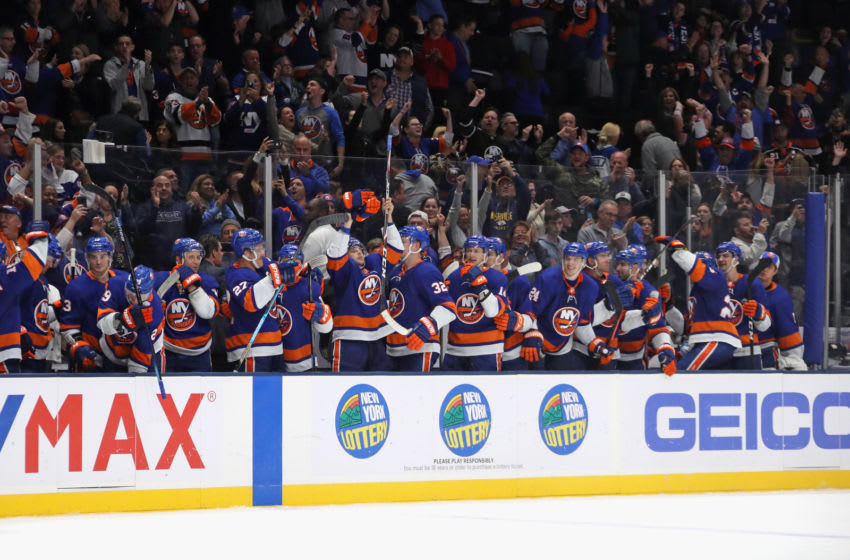UNIONDALE, NEW YORK - OCTOBER 12: The New York Islanders celebrate a 3-2 shoot-out win against the Florida Panthers at NYCB Live's Nassau Coliseum on October 12, 2019 in Uniondale, New York. (Photo by Bruce Bennett/Getty Images)