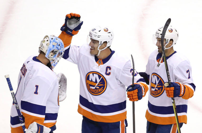 TORONTO, ONTARIO - JULY 29: Thomas Greiss #1 of the New York Islanders is congratulated by teammates Anders Lee #27 and Jordan Eberle #7 after the 2-1 win over the New York Rangers during an exhibition game prior to the 2020 NHL Stanley Cup Playoffs at Scotiabank Arena on July 29, 2020 in Toronto, Ontario. (Photo by Andre Ringuette/Freestyle Photo/Getty Images)