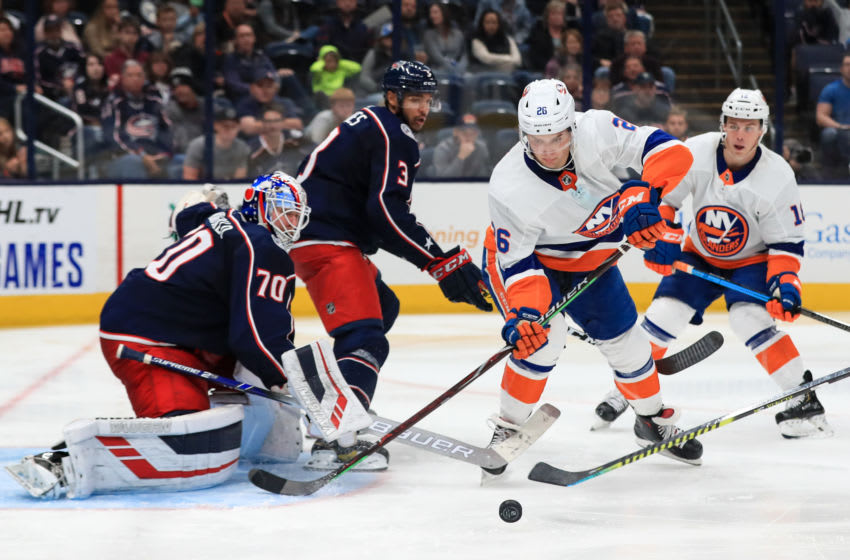 Oct 19, 2019; Columbus, OH, USA; Columbus Blue Jackets goaltender Joonas Korpisalo (70) attempts a save against New York Islanders right wing Oliver Wahlstrom (26) in the third period at Nationwide Arena. Mandatory Credit: Aaron Doster-USA TODAY Sports