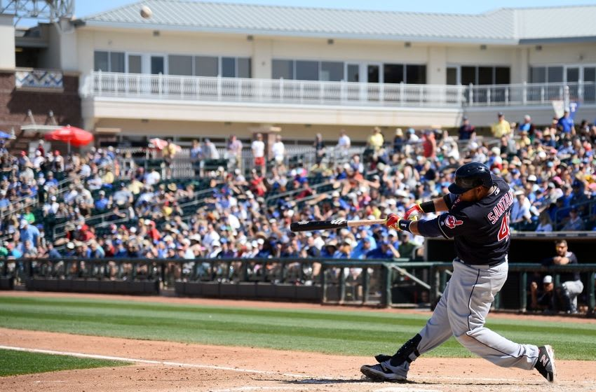 Mar 13, 2016; Surprise, AZ, USA; Cleveland Indians first baseman Carlos Santana (41) hits a pitch during the third inning against the Kansas City Royals at Surprise Stadium. Mandatory Credit: Joe Camporeale-USA TODAY Sports