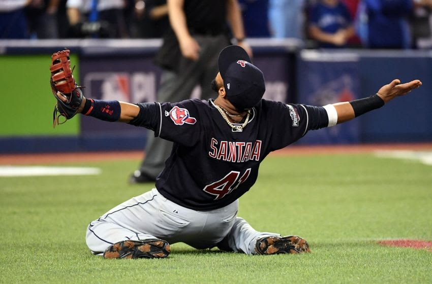 Oct 19, 2016; Toronto, Ontario, CAN; Cleveland Indians first baseman Carlos Santana (41) reacts after making the final catch to beat the Toronto Blue Jays in game five of the 2016 ALCS playoff baseball series at Rogers Centre. Mandatory Credit: Nick Turchiaro-USA TODAY Sports