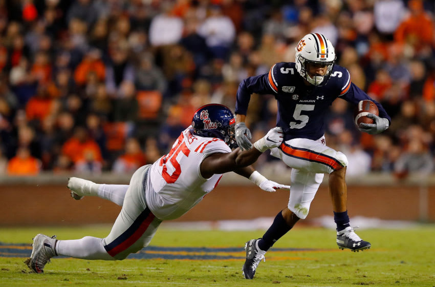 AUBURN, ALABAMA - NOVEMBER 02: Anthony Schwartz #5 of the Auburn Tigers breaks a tackle by Benito Jones #95 of the Mississippi Rebels in the first half at Jordan-Hare Stadium on November 02, 2019 in Auburn, Alabama. (Photo by Kevin C. Cox/Getty Images)