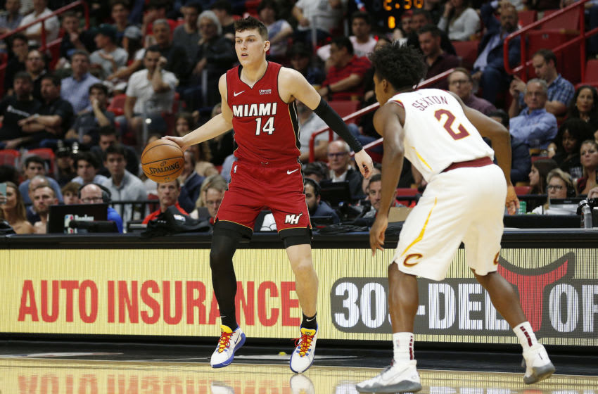 MIAMI, FLORIDA - NOVEMBER 20: Tyler Herro #14 of the Miami Heat drives to the basket against Collin Sexton #2 of the Cleveland Cavaliers during the second half at American Airlines Arena on November 20, 2019 in Miami, Florida. NOTE TO USER: User expressly acknowledges and agrees that, by downloading and/or using this photograph, user is consenting to the terms and conditions of the Getty Images License Agreement. (Photo by Michael Reaves/Getty Images)