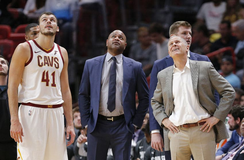 MIAMI, FLORIDA - NOVEMBER 20: Ante Zizic #41, associate head coach J.B. Bickerstaff and head coach John Beilein of the Cleveland Cavaliers watch a video review against the Miami Heat during the first half at American Airlines Arena on November 20, 2019 in Miami, Florida. NOTE TO USER: User expressly acknowledges and agrees that, by downloading and/or using this photograph, user is consenting to the terms and conditions of the Getty Images License Agreement. (Photo by Michael Reaves/Getty Images)