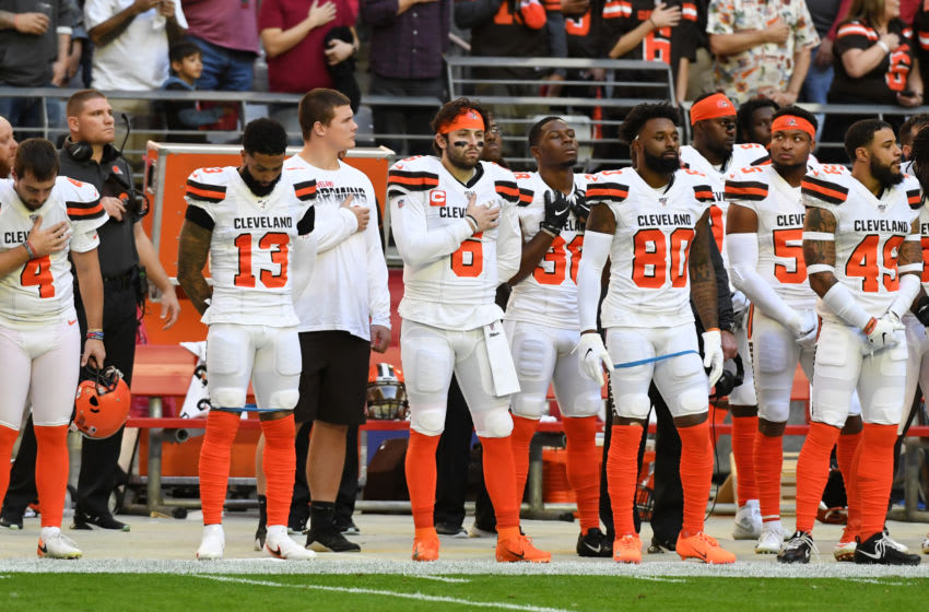 GLENDALE, ARIZONA - DECEMBER 15: Baker Mayfield #6 of the Cleveland Browns stands between receivers Odell Beckham Jr #13 and Jarvis Landry #80 during the singing of the national anthem prior to a game against the Arizona Cardinals at State Farm Stadium on December 15, 2019 in Glendale, Arizona. (Photo by Norm Hall/Getty Images)