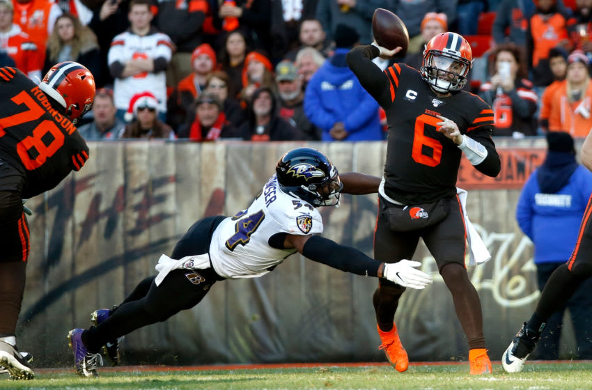 CLEVELAND, OH - DECEMBER 22: Baker Mayfield #6 of the Cleveland Browns throws the ball as he is hit by Tyus Bowser #54 of the Baltimore Ravens during the game at FirstEnergy Stadium on December 22, 2019 in Cleveland, Ohio. Baltimore defeated Cleveland 31-15. (Photo by Kirk Irwin/Getty Images)