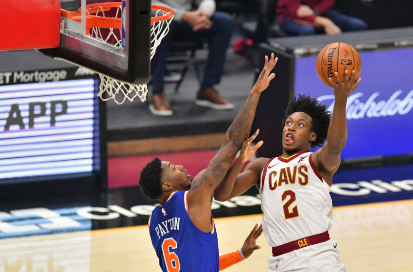 CLEVELAND, OHIO - DECEMBER 29: Collin Sexton #2 of the Cleveland Cavaliers shoots over Elfrid Payton #6 of the New York Knicks during the first quarter at Rocket Mortgage Fieldhouse on December 29, 2020 in Cleveland, Ohio. NOTE TO USER: User expressly acknowledges and agrees that, by downloading and/or using this photograph, user is consenting to the terms and conditions of the Getty Images License Agreement. (Photo by Jason Miller/Getty Images)