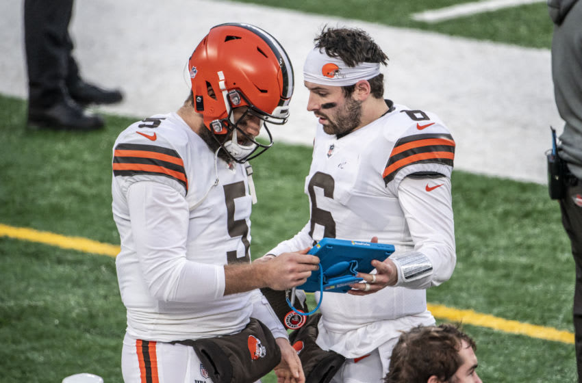 EAST RUTHERFORD, NJ - DECEMBER 27: Case Keenum #5 and Baker Mayfield #6 of the Cleveland Browns on the sideline during a game against the New York Jets at MetLife Stadium on December 27, 2020 in East Rutherford, New Jersey. (Photo by Benjamin Solomon/Getty Images)