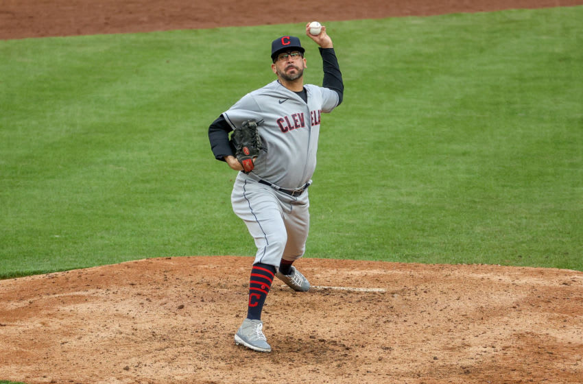 CINCINNATI, OHIO - APRIL 17: Oliver Perez #39 of the Cleveland Indians pitches in the tenth inning against the Cincinnati Reds at Great American Ball Park on April 17, 2021 in Cincinnati, Ohio. (Photo by Dylan Buell/Getty Images)