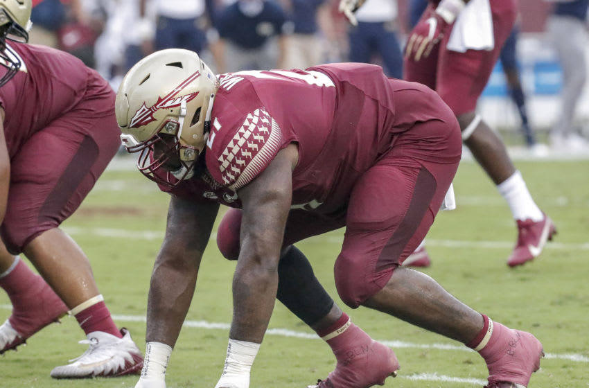 TALLAHASSEE, FL - SEPTEMBER 12: Defensive End Marvin Wilson #21 of the Florida State Seminoles during the game against the Georgia Tech Yellow Jackets at Doak Campbell Stadium on Bobby Bowden Field on September 12, 2020 in Tallahassee, Florida. The Yellow Jackets defeated the Seminoles 16 to 13. (Photo by Don Juan Moore/Getty Images)