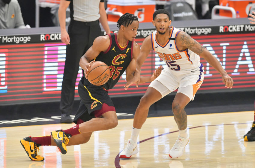 CLEVELAND, OHIO - MAY 04: Isaac Okoro #35 of the Cleveland Cavaliers drives around Cameron Payne #15 of the Phoenix Suns during the first quarter at Rocket Mortgage Fieldhouse on May 04, 2021 in Cleveland, Ohio. NOTE TO USER: User expressly acknowledges and agrees that, by downloading and/or using this photograph, user is consenting to the terms and conditions of the Getty Images License Agreement. (Photo by Jason Miller/Getty Images)