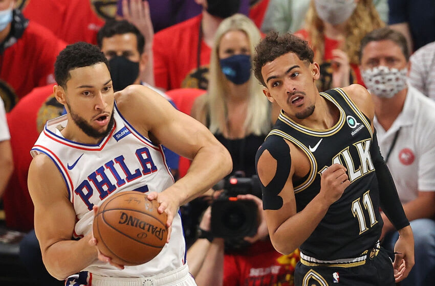 ATLANTA, GEORGIA - JUNE 14: Ben Simmons #25 of the Philadelphia 76ers grabs a rebound against Trae Young #11 of the Atlanta Hawks during the first half of game 4 of the Eastern Conference Semifinals at State Farm Arena on June 14, 2021 in Atlanta, Georgia. NOTE TO USER: User expressly acknowledges and agrees that, by downloading and or using this photograph, User is consenting to the terms and conditions of the Getty Images License Agreement. (Photo by Kevin C. Cox/Getty Images)