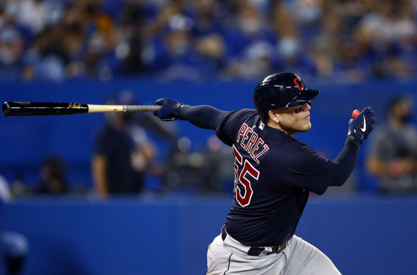 TORONTO, ON - AUGUST 03: Roberto Perez #55 of the Cleveland Indians bats during a MLB game against the Toronto Blue Jays at Rogers Centre on August 03, 2021 in Toronto, Canada. (Photo by Vaughn Ridley/Getty Images)