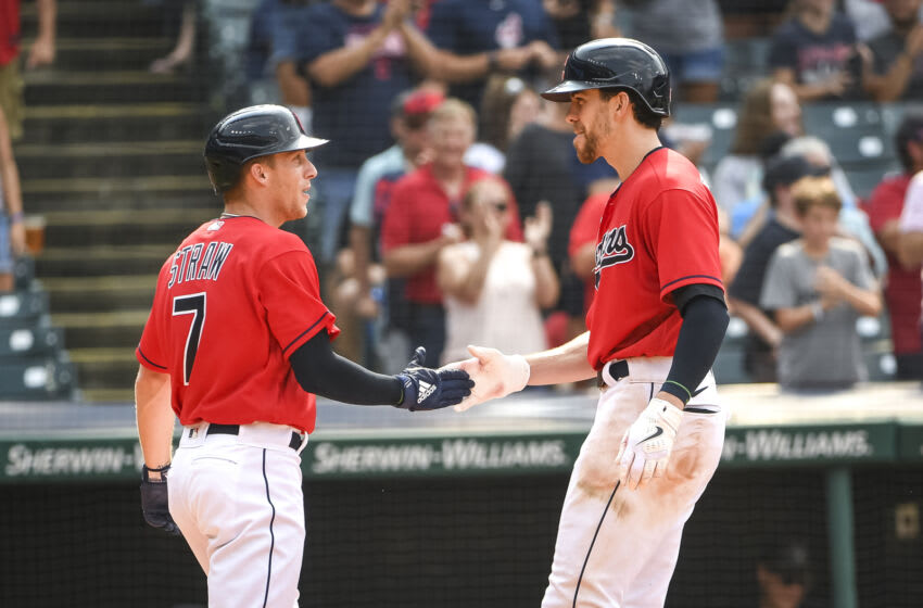 CLEVELAND, OHIO - AUGUST 08: Myles Straw #7 of the Cleveland Indians high fives Bradley Zimmer #4 of the Cleveland Indians after Zimmer homered on a fly ball to right center field against the Detroit Tigers during the bottom of the seventh inning at Progressive Field on August 08, 2021 in Cleveland, Ohio. (Photo by Nic Antaya/Getty Images)