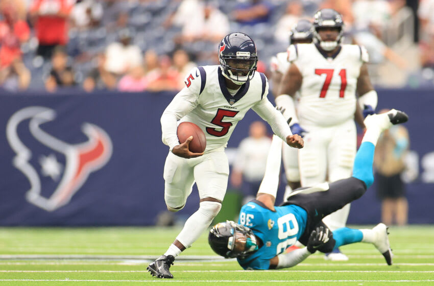 HOUSTON, TEXAS - SEPTEMBER 12: Tyrod Taylor #5 of the Houston Texans runs with the ball during the fourth quarter against the Jacksonville Jaguars at NRG Stadium on September 12, 2021 in Houston, Texas. (Photo by Carmen Mandato/Getty Images)