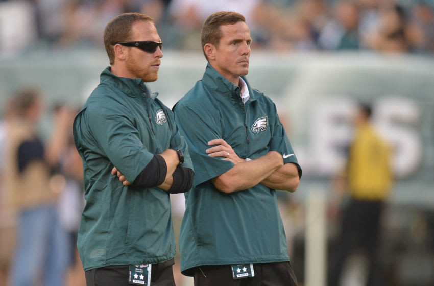 PHILADELPHIA, PA - AUGUST 09: Shaun Huls and Dave Fipp watch warm ups before the game against the New England Patriots at Lincoln Financial Field on August 9, 2013 in Philadelphia, Pennsylvania. (Photo by Drew Hallowell/Philadelphia Eagles/Getty Images)