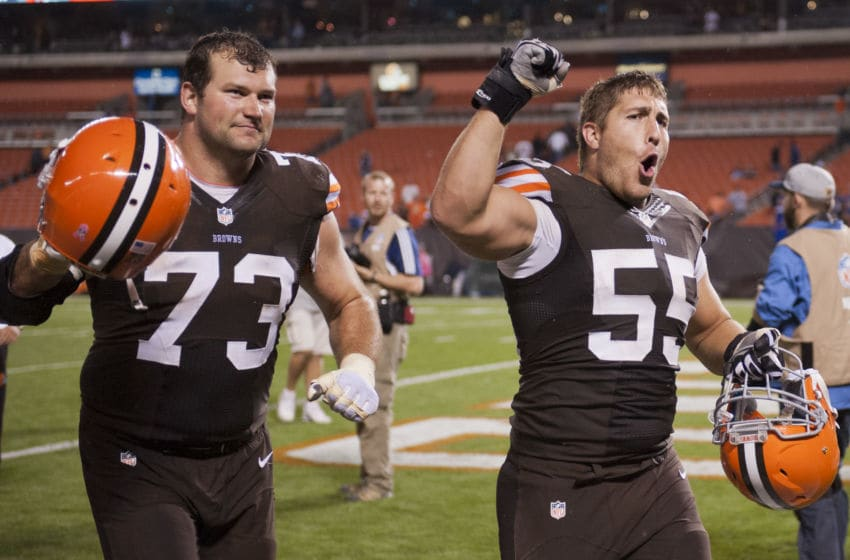 CLEVELAND, OH - OCTOBER 3: Tackle Joe Thomas #73 and center Alex Mack #55 of the Cleveland Browns celebrate after defeating the Buffalo Bills during the first half at FirstEnergy Stadium on October 3, 2013 in Cleveland, Ohio. The Browns defeated the Bills 37-24. (Photo by Jason Miller/Getty Images)