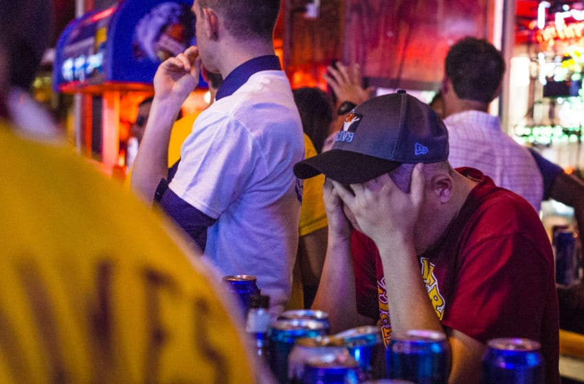CLEVELAND, OH- JUNE 16: A Cleveland Cavaliers fan holds his head while watching Game 6 of the NBA Finals at Paninis Bar and Grill on June 16, 2015 in Cleveland, Ohio. The Golden State Warriors defeated The Cleveland Cavaliers 105-97 to win their first championship since 1975. (Photo by Angelo Merendino/Getty Images)