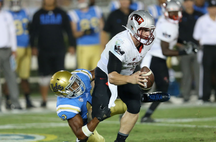PASADENA, CA - SEPTEMBER 10: Linebacker Kenny Young #42 of the UCLA Bruins sacks quarterback Johnny Stanton #4 of the UNLV Rebels in the third quarter at the Rose Bowl on September 10, 2016 in Pasadena, California. UCLA won 42-21. (Photo by Stephen Dunn/Getty Images)