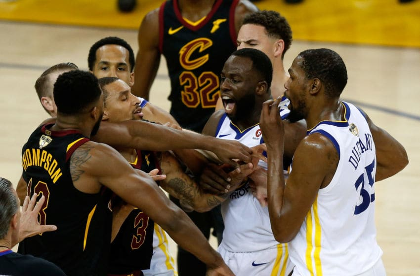 OAKLAND, CA - MAY 31: Tristan Thompson #13 of the Cleveland Cavaliers and Draymond Green #23 of the Golden State Warriors exchange words in overtime during Game 1 of the 2018 NBA Finals at ORACLE Arena on May 31, 2018 in Oakland, California. NOTE TO USER: User expressly acknowledges and agrees that, by downloading and or using this photograph, User is consenting to the terms and conditions of the Getty Images License Agreement. (Photo by Lachlan Cunningham/Getty Images)
