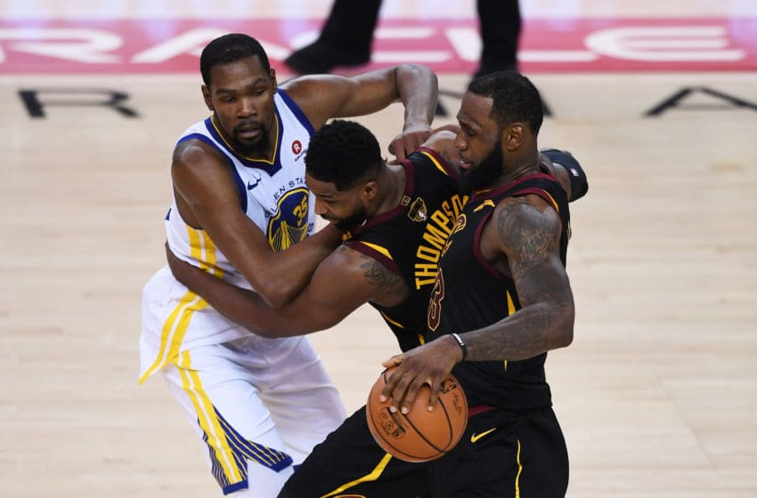 OAKLAND, CA - MAY 31: Kevin Durant #35 of the Golden State Warriors drives against Tristan Thompson #13 and LeBron James #23 of the Cleveland Cavaliers in Game 1 of the 2018 NBA Finals at ORACLE Arena on May 31, 2018 in Oakland, California. NOTE TO USER: User expressly acknowledges and agrees that, by downloading and or using this photograph, User is consenting to the terms and conditions of the Getty Images License Agreement. (Photo by Thearon W. Henderson/Getty Images)