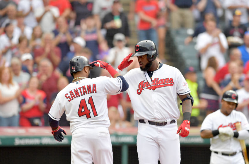 CLEVELAND, OHIO - AUGUST 12: Carlos Santana #41 of the Cleveland Indians celebrates with Franmil Reyes #32 after both scored on Reyes' home run in the first inning against the Boston Red Sox at Progressive Field on August 12, 2019 in Cleveland, Ohio. (Photo by Jason Miller/Getty Images)